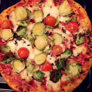 Organic brussels sprout and tomato pizza